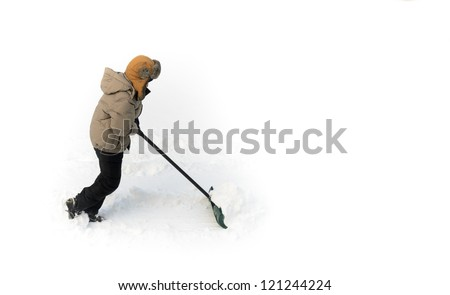 Boy pushing snow with shovel - stock photo