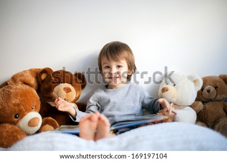 Boy, reading a book, educating himself