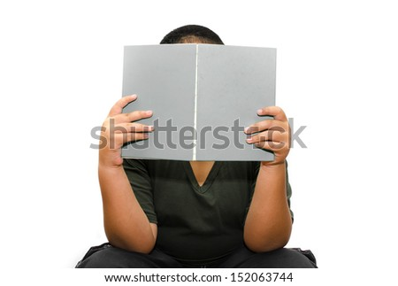 Boy reading a book , isolated over white background - stock photo