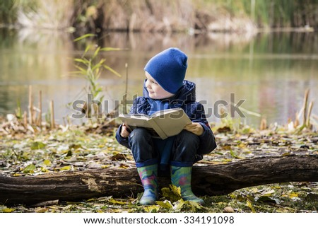 boy reading a book, nature autumn