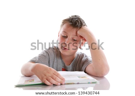 boy reading a book on a white background - stock photo