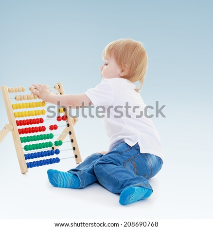 boy reading a Montessori classroom.Summer fun, the concept of happiness and family wellbeing. - stock photo