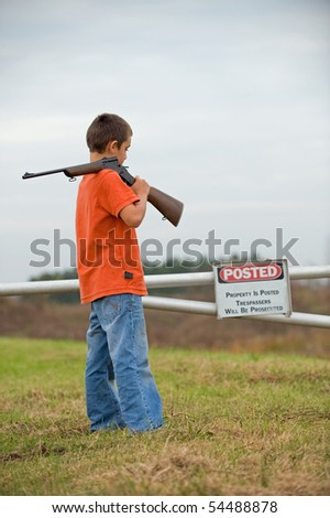 Boy reading posted sign - stock photo