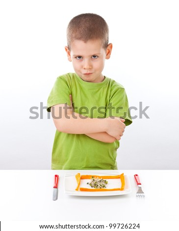 Boy refuses to eating healthy food, isolated on white - stock photo