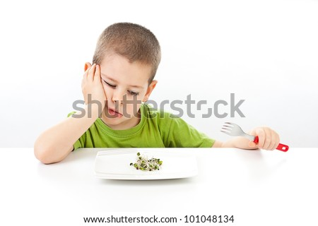 Boy refuses to eating healthy food, white background
