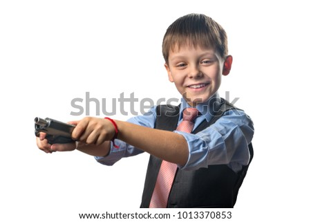 Boy reloads a gun on a white background