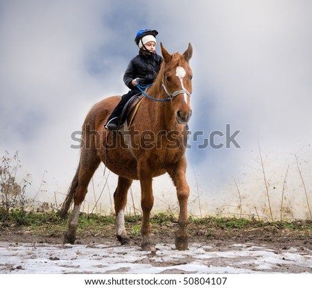 Boy Riding School learns to be a rider - stock photo