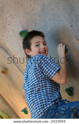 Boy rock climbing. #1 - stock photo