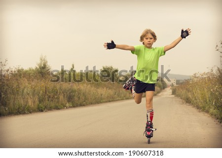 Boy rollerblading on a public road. - stock photo