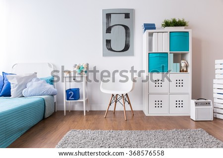 Boy room in white and blue with flooring and carpet - stock photo