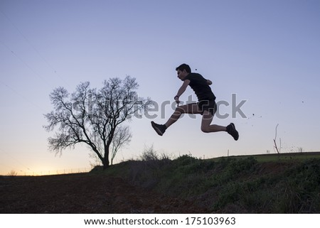 boy running in the natural place