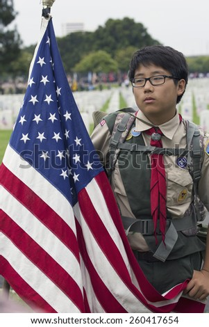 Boy scout placing 85, 000 US Flags at Annual Memorial Day Event, Los Angeles National Cemetery, California, USA, 05.24.2014