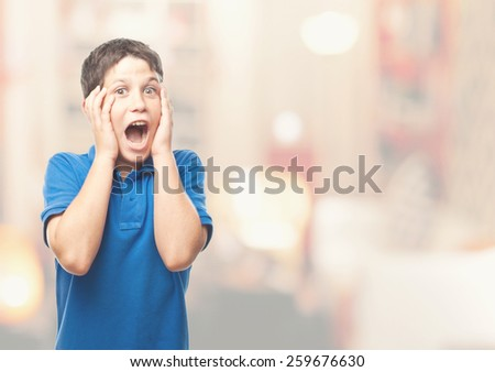 boy screaming in a living room - stock photo