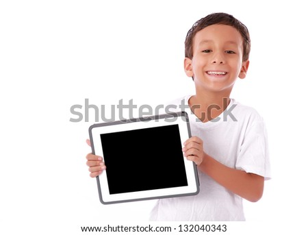 Boy showing a  tablet isolated over white background
