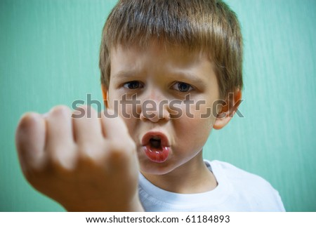 Boy showing his fist.