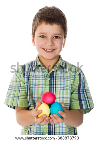 boy showing painted easter eggs, isolated on white - stock photo