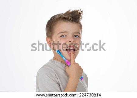 boy shows his hurting teeth - stock photo