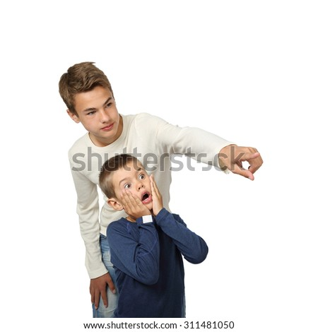 Boy shows something amazing to his little brother isolated on square white background - stock photo