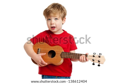 Boy singing and playing guitar shot in the studio on a white background. - stock photo
