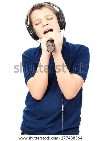 Boy singing into a microphone. Very emotional. - stock photo