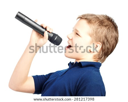 Boy singing into a microphone. Very emotional.