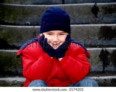 boy sitting and smile - stock photo
