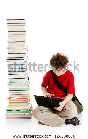 Boy sitting close to pile of books on white background - stock photo