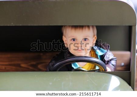 Boy sitting in car - stock photo
