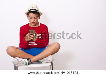 boy sitting isolated with mobile phone