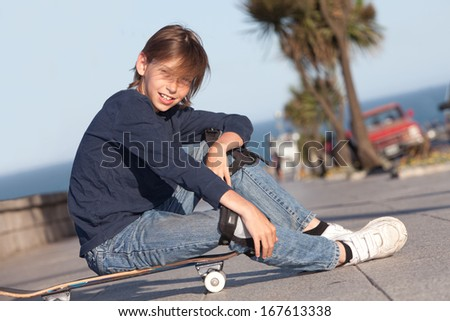 boy sitting on a skateboard