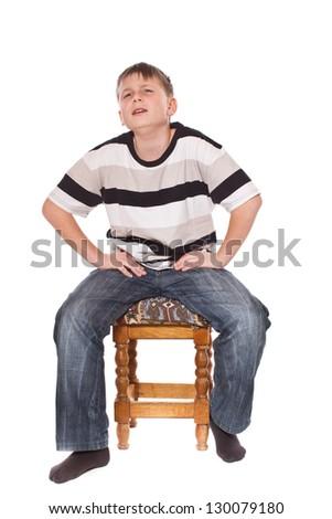 boy sitting on a stool on a white background - stock photo