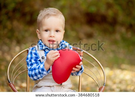 boy sitting on a wicker chair - stock photo