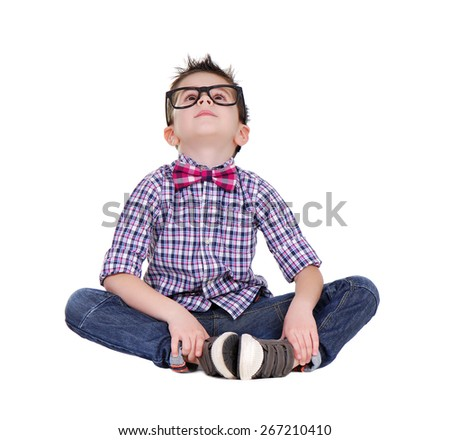boy sitting on the floor looking up to the copy space area - stock photo