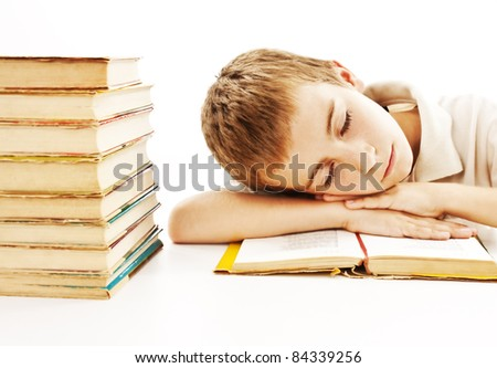 Boy sleep on the table. Isolated on white background - stock photo