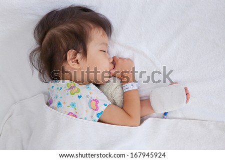 Boy sleeping in hospital patients - stock photo