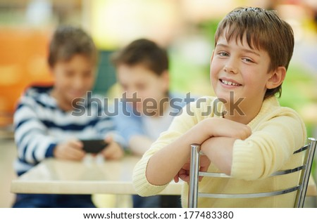 Boy smiling at camera in cafe  - stock photo