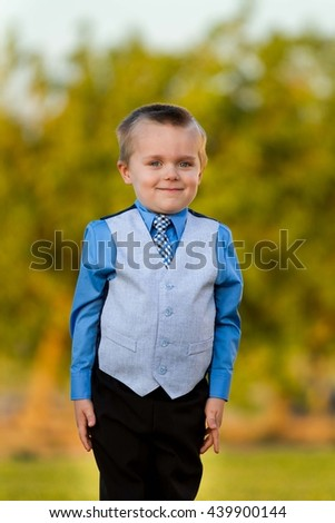 Boy smiling while wearing his suit and tie - stock photo