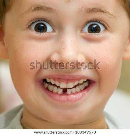 Boy smiling without one teeth - stock photo
