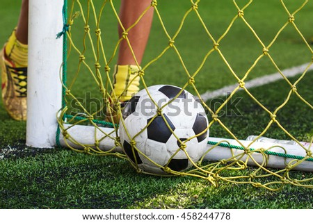 Boy Soccer Goal mesh in  grass   with Training in Soccer academy.