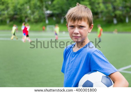 Boy soccer player in training on a soccer field