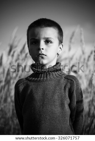 boy standing black and white photography