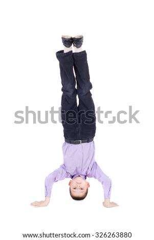 boy standing head over feet - stock photo