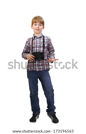 Boy stands with camera on his neck isolated on white background