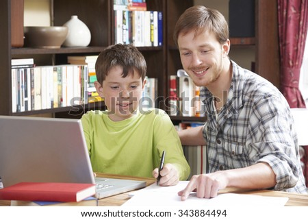 Boy Studying With Home Tutor - stock photo