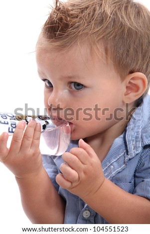 Boy sucking bottle