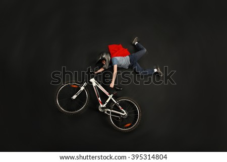 Boy superhero doing an extreme bike jump