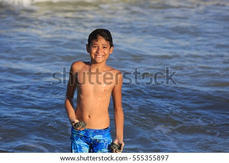 Boy swimming and playing on the beach