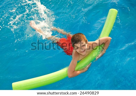 Boy swims in the pool - stock photo