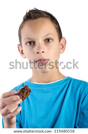 boy  taking a bite of a muffin - stock photo