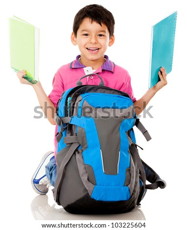 Boy taking out notebooks from a school bag - isolated over a white background - stock photo